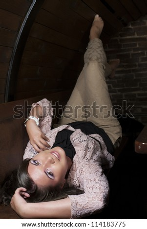 Young girl lying on her back