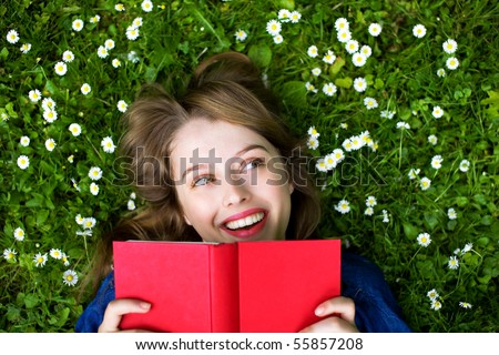 Young Girl Lying on the Grass - stock photo