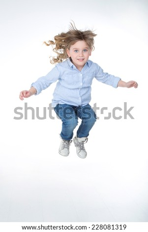 young girl make a jump with self confidence - stock photo