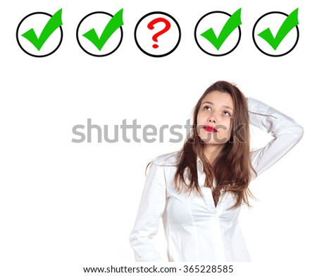 Young girl makes a choice. Putting rating. Yes or not that is the question a woman thinks. On a white background. Green YES sign near the girl. - stock photo