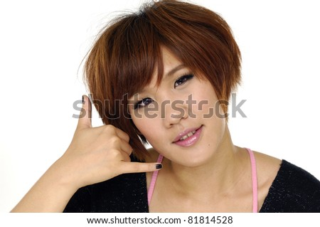 young girl making a call me gesture - stock photo
