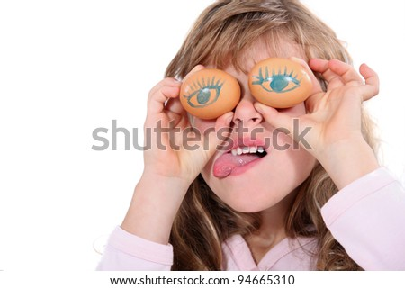 Young girl making a funny face - stock photo