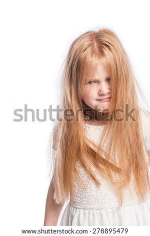 Young girl making a funny face with lots of hair in studio on white background. - stock photo