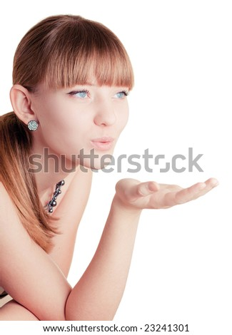 Young girl making blow kiss on white background - stock photo