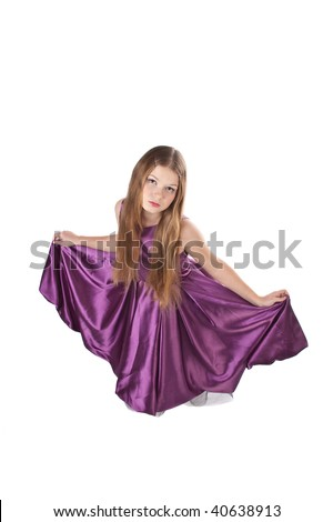 young girl making curtsey in violet evening dress isolated on white