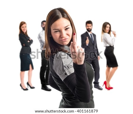 young girl making horn gesture over white background  - stock photo