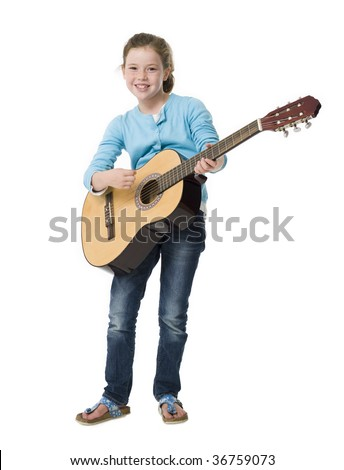 Young girl making music playing a guitar on white background