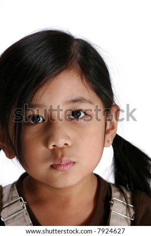 Young girl making pouty face - stock photo