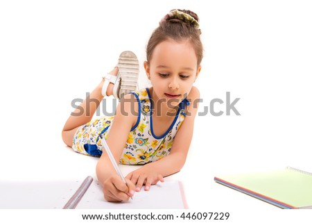 Young girl making some draws - isolated over white - stock photo