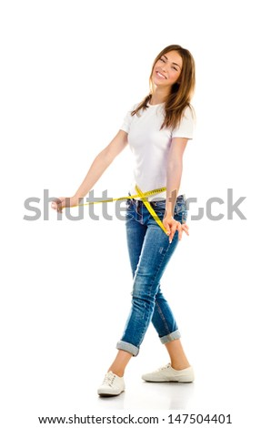 young girl measuring her waist isolated on a white background - stock photo