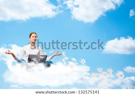 young girl meditating on the clouds with a laptop, dreaming at work - stock photo