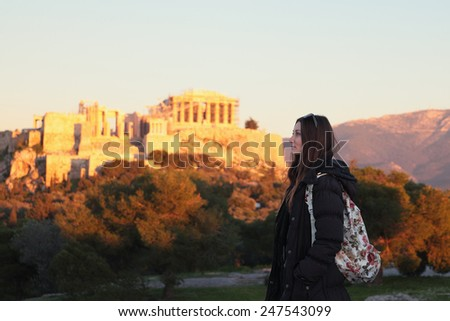 Young girl near fire sunset acropolis.Student in Athens,Greece. - stock photo