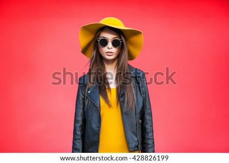 Young girl near the color wall  - stock photo