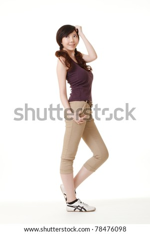 Young girl of Asian beauty, full length portrait in studio white background. - stock photo