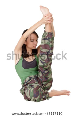 Young girl of Asian doing stretch excise isolated over white. - stock photo