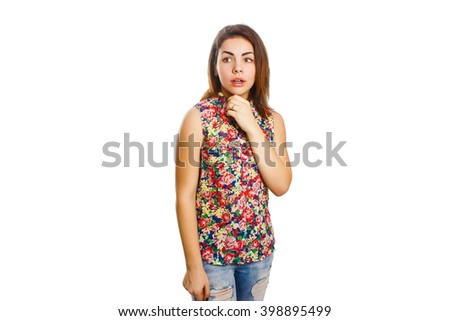 young girl of eighteen in a motley jacket gasped looking forward on a white background, surprise - stock photo