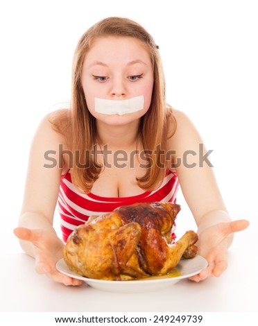 Young girl on a diet, and want to eat meat, isolated on white background - stock photo