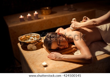 Young girl on a spa massage - stock photo