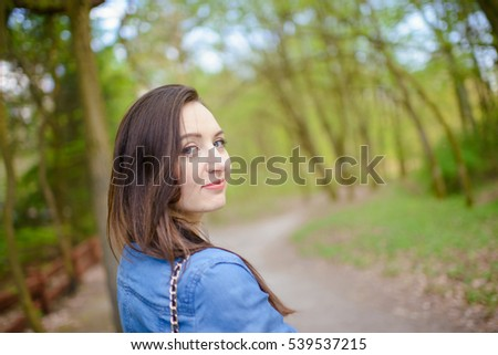 Young girl on a walk in the forest.