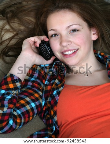 Young girl on cell phone - stock photo