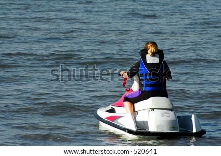Young Girl on Jet-ski - stock photo