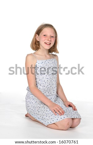 young girl on knees, smiling