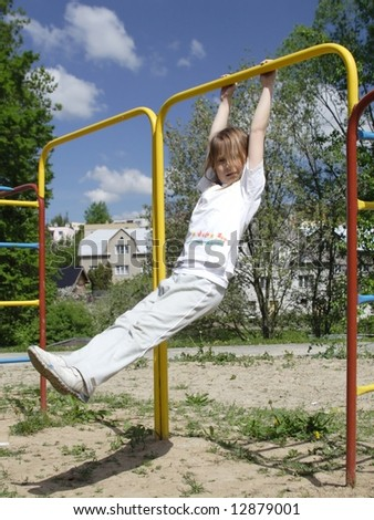 Young girl on metal playstructure - stock photo