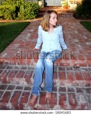 Young Girl On Steps - stock photo
