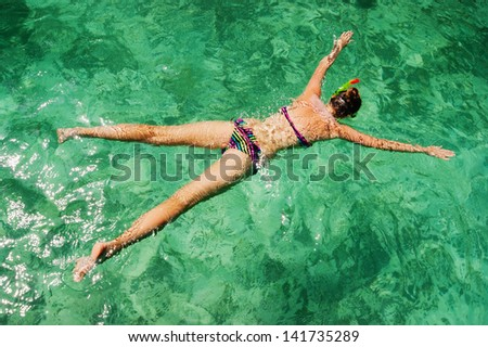 young girl on the beach snorkel Maya Bay on Phi Phi Ley, Thailand - stock photo