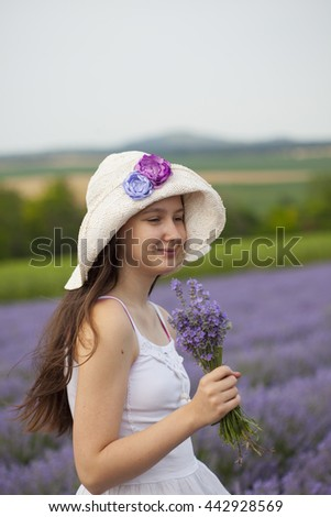Young girl on the lavender field in Provance - stock photo
