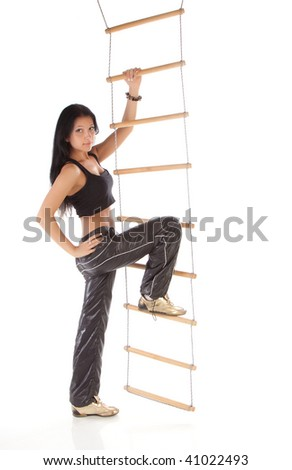 Young girl on the rope ladder