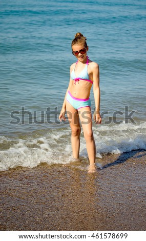 young girl on the sea coast
