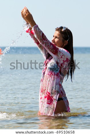 young girl on the sea in summer - stock photo