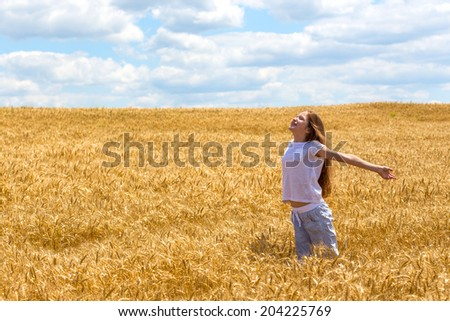 young girl on the wheat field   - stock photo