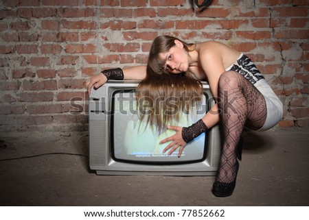 young girl on vintage TV receiver. expressed face - stock photo