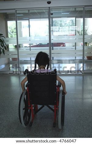 Young girl on wheelchair leaving hospital - stock photo