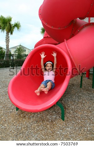 Young girl outside playing on a playground - stock photo