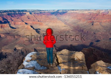 Young girl overlooking in Grand Canyon National Park,Arizona - stock photo