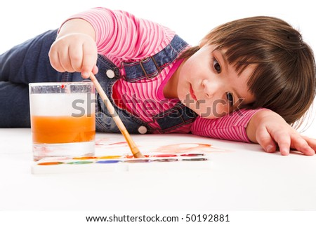 Young girl painted white paper on white background