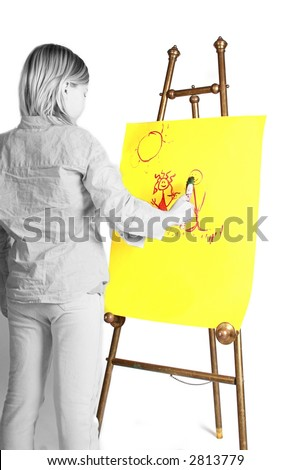 young girl painting on a easel, yellow paper. - stock photo