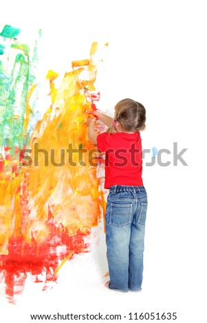 young girl painting over white wall - stock photo