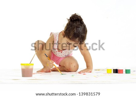 young girl painting picture on a white background - stock photo