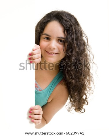 young girl peeking behind a white wall/sign. - stock photo