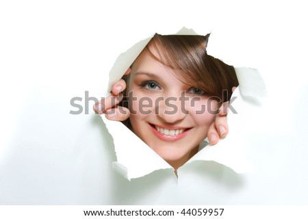 young girl peeping through hole in paper - stock photo