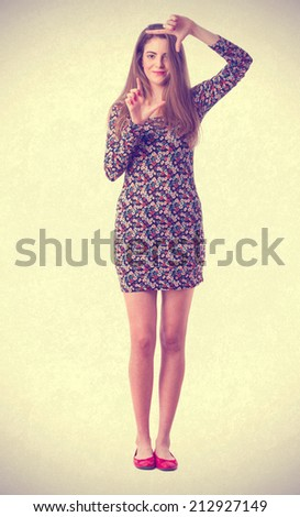 Young girl photograph gesture - stock photo