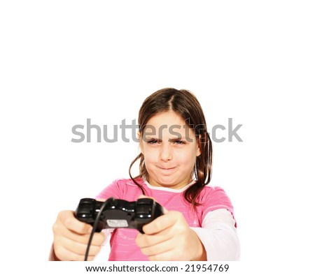 young girl playing a video game with isolated background. - stock photo