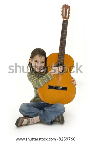 young girl playing acoustic guitar - stock photo