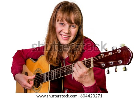Young girl playing acoustic guitar - isolated on white background