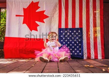 Young girl playing at park, celebrating her first birthday -- image taken at San Rafael park in Reno, Nevada, USA - stock photo