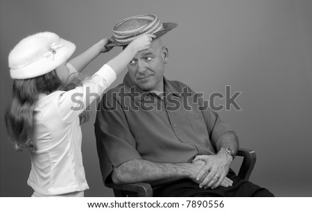 Young Girl Playing Dress-Up With Dad
